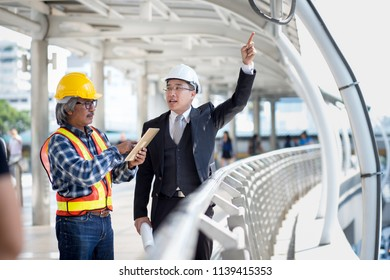 Businessman and Engineer closed circuit camera or security camera consulting