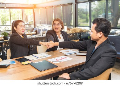Businessman and engineer working hands of business people join hand together. Teamwork Concept,A group of positive colleagues pointing their fingers at the camera
