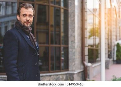 Businessman enjoying walk in town