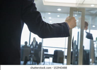 Businessman Entering an Office