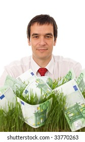 Businessman with euro banknotes in grass - green business concept, isolated