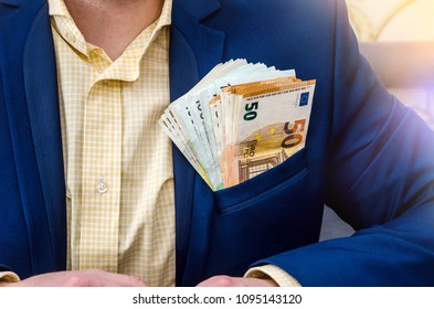 Businessman with euro notes in his jacket pocket