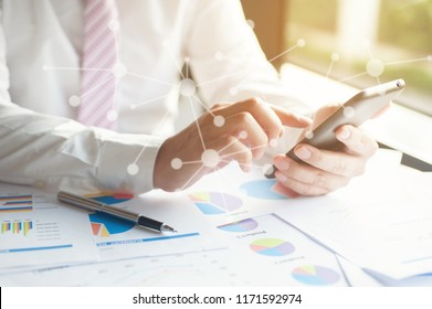 Businessman Examine Finance, TAX, Accounting,Statistics and Analytic Research for Restructure,   Accountants and Investors Connect with Smartphones,Vision Mission concepts