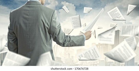 Businessman examining document in hands. Signing contract