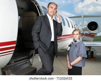 Businessman exiting private jet