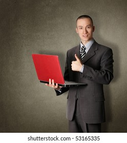 businessman in expensive suit with red laptop