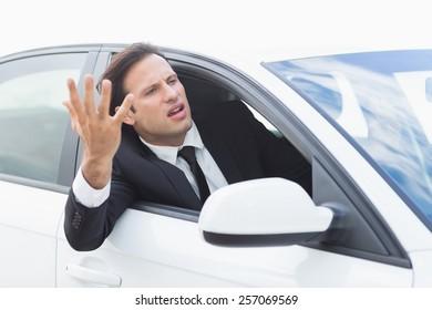 Businessman experiencing road rage in his car