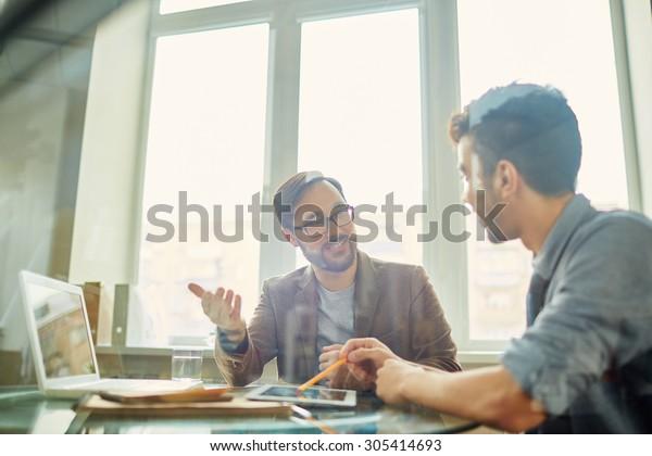 Businessman explaining his idea or opinion to colleague