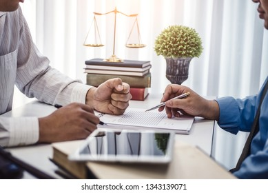 Businessman explaining terms and conditions with contract  insurance agreement before he sign the document.
