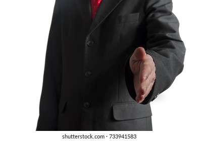 businessman extending hand to shake on white background
