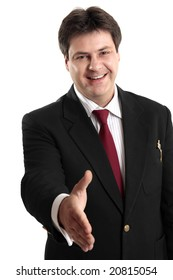 Businessman extends his hand to seal a deal or greeting a fellow colleague or businessman.
