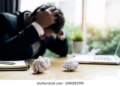 Businessman failure project plan deadline serious emotion and depression or deadline at office room with paperwork report on working table
