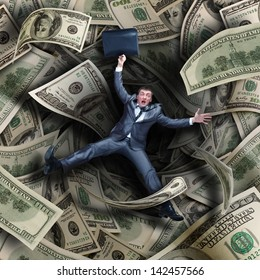 Businessman falling into tunnel of $100 dollar bills