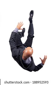 Businessman falling isolated in white