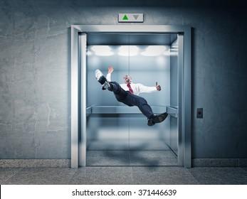 businessman falling in modern elevator