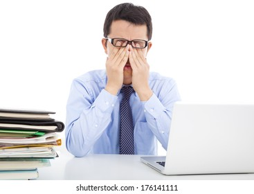 businessman is too fatigued to rubbing his eyes