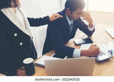 Businessman feel sad worry tired frustrated upset fail after lost work job from office . he become unhappy and depressed person But a colleague cheering alongside.