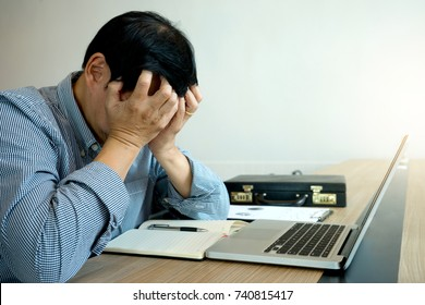 businessman feel upset use his hand over his face sad unhappy