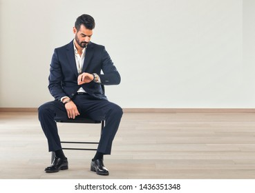 Businessman feeling worried and checking his watch, Businessman sitting on chair and waiting