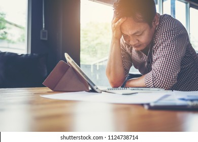 businessman feeling worried and tired on business unsuccessful