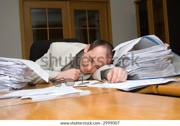 Businessman felt asleep late night in the office