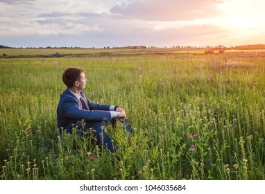 Businessman in the field, with a laptop. Happy, successful