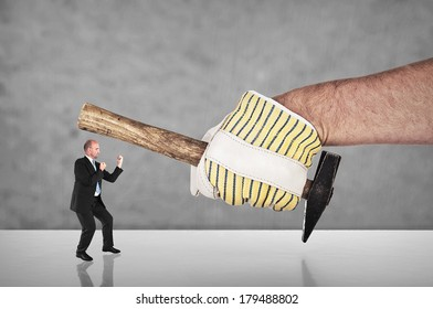 Businessman fighting with a hand with blank work glove