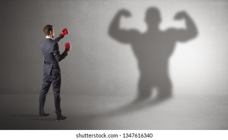 Businessman fighting with his bossy yelling shadow