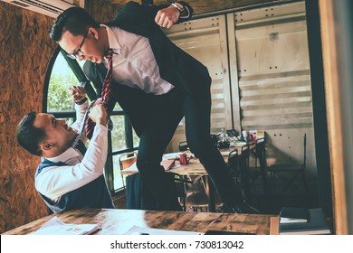 Businessman fighting with his coworker in office.
