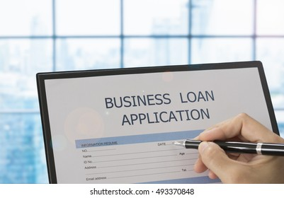 Businessman fill information on business loan application form.