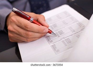 businessman filling in the tax form