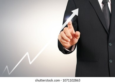 businessman with financial symbols coming from hand ,touch chart stock