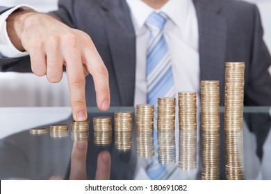 Businessman Finger Go Up To The Top Of Stack Coin With Concept Growth Finance