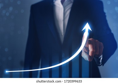 Businessman finger pointing arrow graph. Business development to success, profit and growing growth plan.