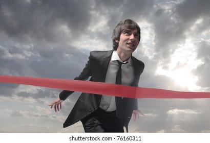 Businessman finishing a race