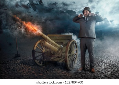 Businessman firing with old cannon