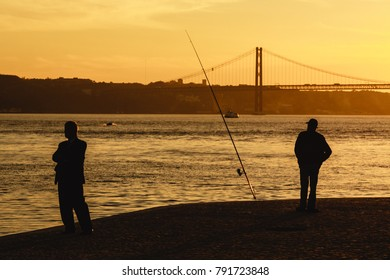 Businessman and fisherman on Tagus bank in Lisbon