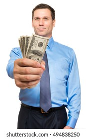Businessman with fistful of money on white