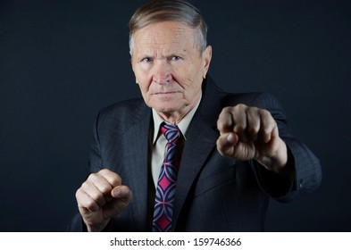 Businessman with fists ready to fight
