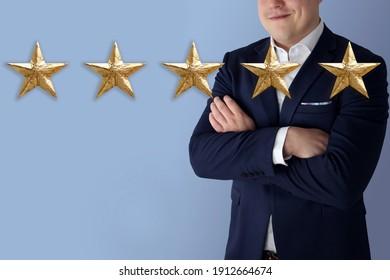businessman, five gold foil star on blue background, concept of evaluating the result, rating, Satisfaction