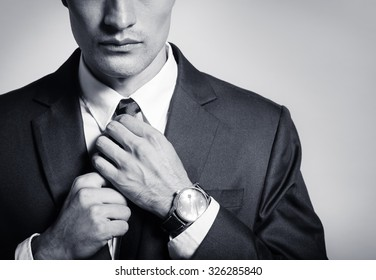 Businessman fixing his tie.