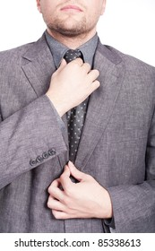 businessman fixing his tie with both hands