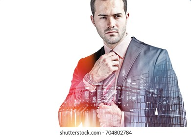 Businessman fixing his tie isolated over white double exposure