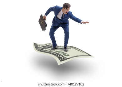 Businessman flying carpet made of dollar currency