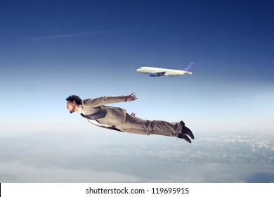 Businessman flying near an airliner