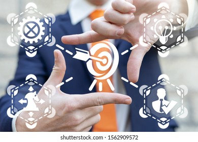 Businessman focuses his hands in form of rectangular frame on target. Aim Goals Business Successful Concept.