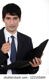 Businessman with folder and pen