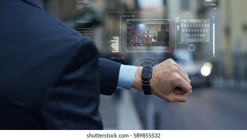 A businessman is followed by a conference on the economy and finance that appears in hologram clock futuristic and technological. Concept: network, conference, technology, augmented reality and future