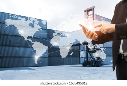 businessman or Foreman control loading Containers box from Cargo and inspector checking Containers box with shipping containers before departure for export business logistic company