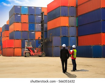 Businessman with foreman logistics engineer is standing in front of containers